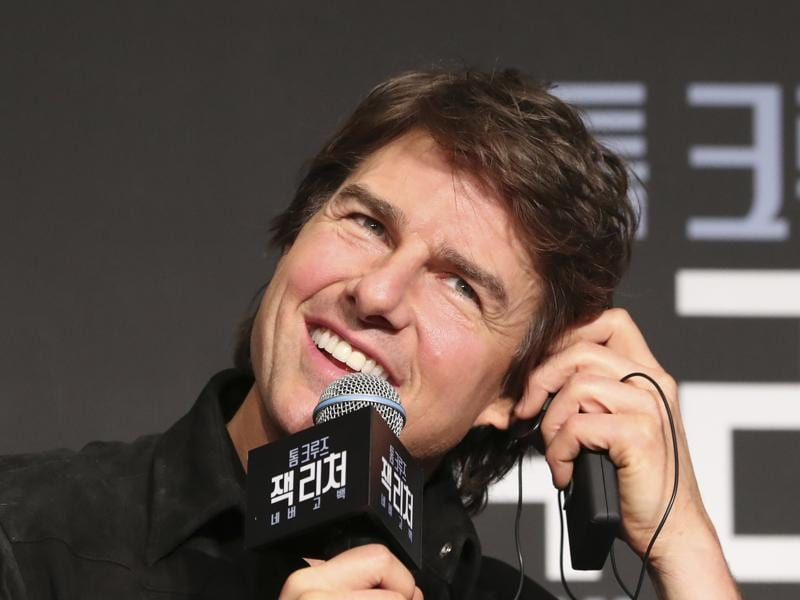 Actor Tom Cruise adjusts his ear phone during a press conference for his new movie Jack Reacher: Never Go Back in Seoul. (AP)
