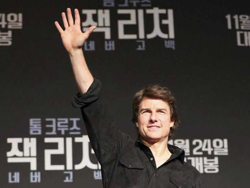 Actor Tom Cruise waves to the audience after finishing a press conference for his new movie Jack Reacher: Never Go Back in Seoul, South Korea. (AP)