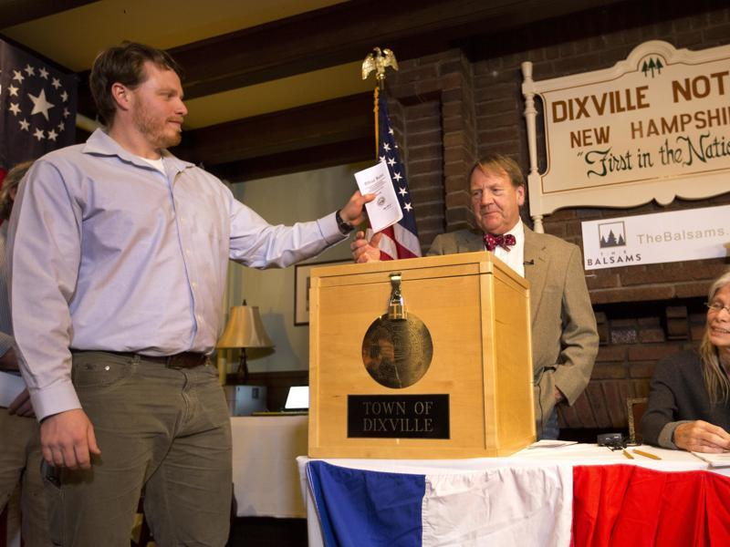 Dixville Notche's first voter Clay Smith drops his ballot into the box as moderator Tom Tillotson watches in Dixville Notch,  New Hampshire. Democratic candidate Hillary Clinton beat Republican Donald Trump 4-2.  (AP)