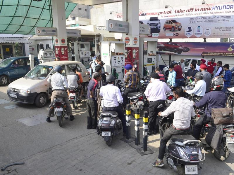 People waiting for their turn at a petrol pump in Amritsar on Wednesday. (Sameer Sehgal/HT Photo)