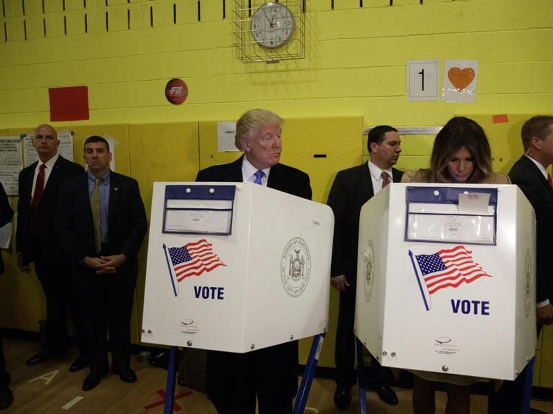 Republican presidential candidate Donald Trump looks at his wife Melania as they cast their votes at PS-59 on November 8. (AP)