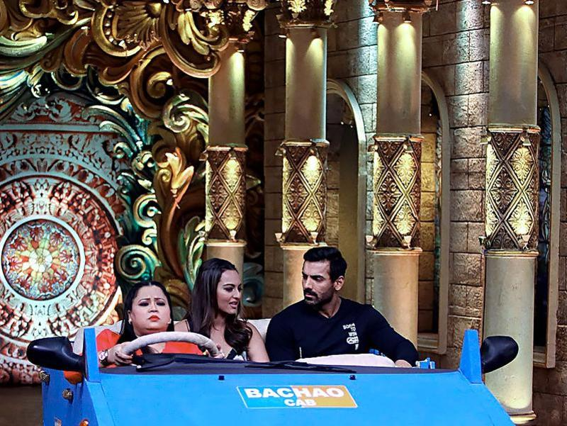 Bharti invited John and Sonakshi for a ride on the sets. (AFP Photo)