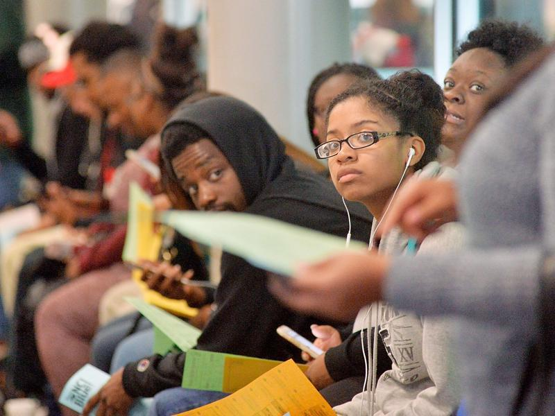 Students of North Carolina Central University wait in a long line during a countywide clinch in the Board of Elections' computer system on November 8 in Durham, North Carolina. The young African American vote could be crucial to the battleground state.  (AFP)
