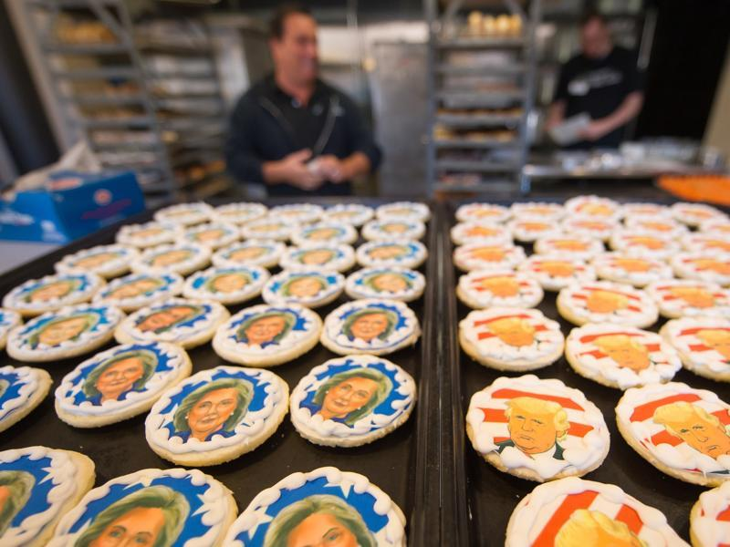 Donald Trump and Hillary Clinton cookies are on sale at the Oakmont Bakery on November 8, 2016 in Oakmont, Pennsylvania. Trump leads the cookie-purchase tally with 63% of the purchases, with a total of 2609 Trump cookies and 1512 Hillary cookies sold as of election day as Americans go to the polls to decide on their next president.  (AFP)