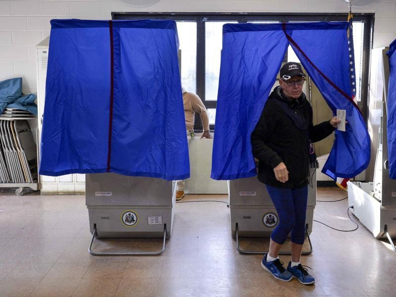 A voter leaves the polling booth during the U.S. presidential election in Philadelphia, Pennsylvania. (REUTERS)