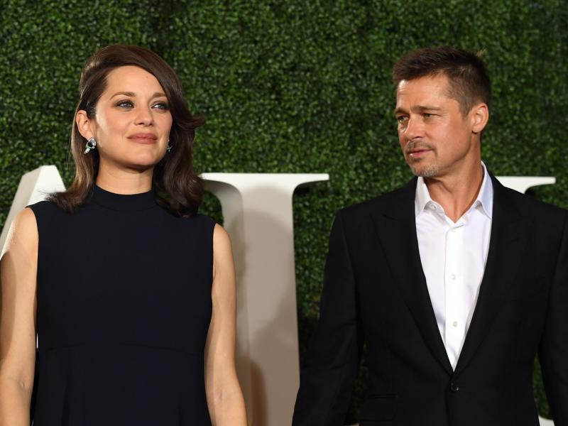 Actress Marion Cotillard (L) and actor Brad Pitt attend the premiere of Paramount Pictures' Allied at Regency Village Theatre. I was previously rumoured that Pitt's separation from wife Angelina Jolie was because of an affair he had with Cotillard, which she denied. (AFP)