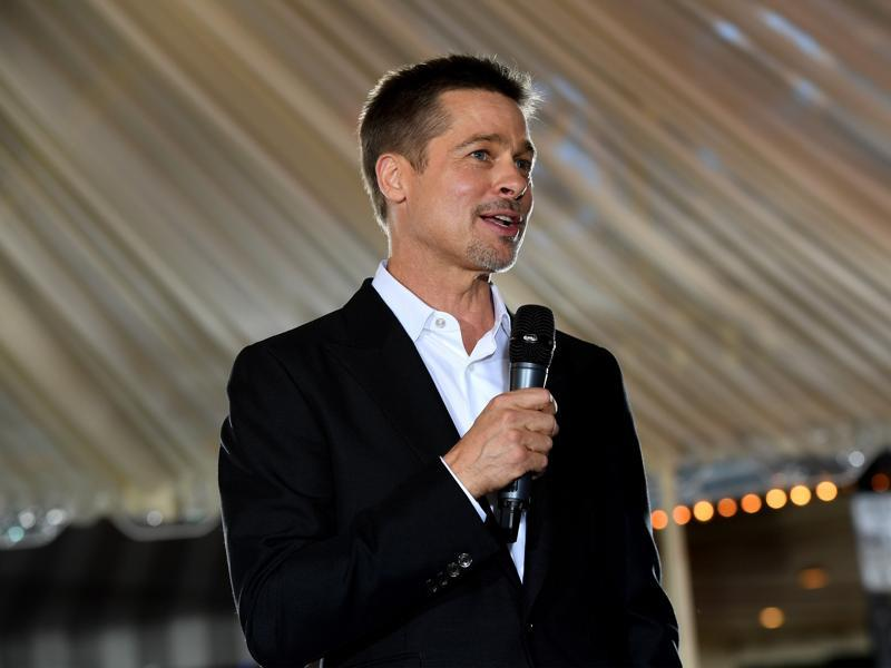 Actor Brad Pitt speaks at  the fan event for Paramount Pictures' Allied at Regency Village Theatre. (AFP)