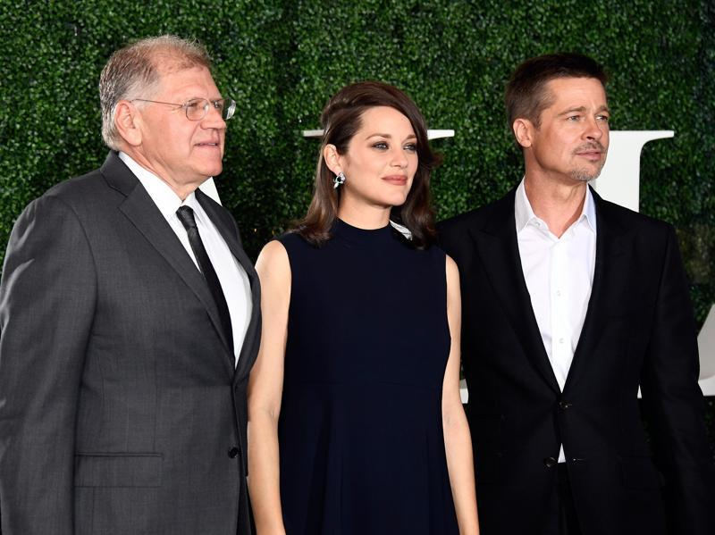 (L-R) Director Robert Zemeckis, actors Marion Cotillard and Brad Pitt at the Allied premiere. Pitt previously stated that he would not be participating in the promotions of Allied. (AFP)