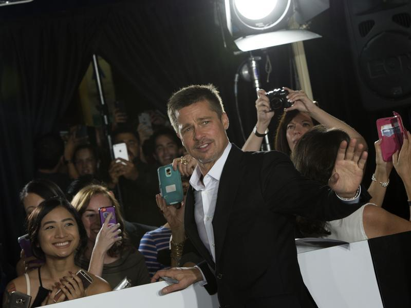 Brad Pitt waves to the crowd at the premiere of  Allied in Westwood, California. (AFP)