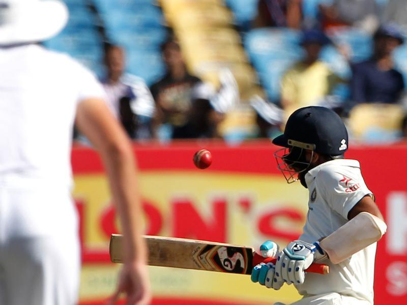 Cheteshwar Pujara withstood a hostile spell from Chris Woakes. He was hit on the helmet three times. (BCCI)