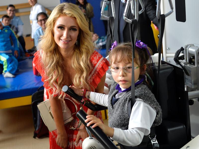 American socialite Paris Hilton is known for her philanthropic activities. The Simple Life star took out some time to meet the children at the Teleton foundation in Tlalnepantla, Mexico state, Mexico on Thursday.  (AFP)
