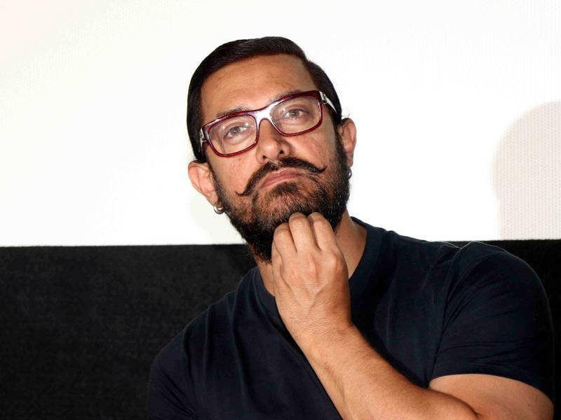 Aamir Khan looks on during a promotional event for the forthcoming Hindi film Dangal in Mumbai. (AFP Photo)