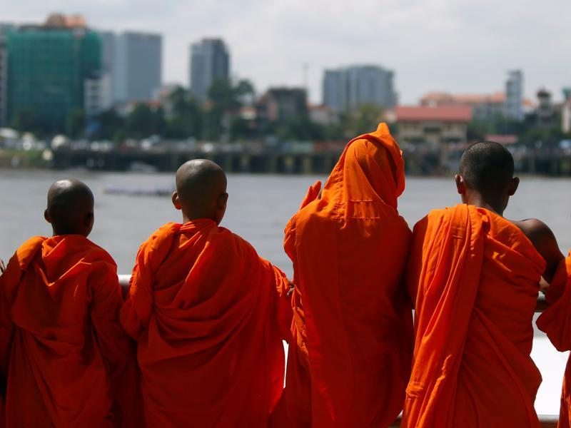 Buddhist monks at the start of a boat race near the Royal Palace during the annual Water Festival on the Tonle Sap river in Phnom Penh. (Reuters)