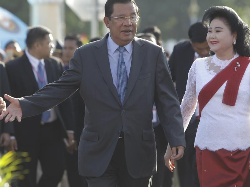 Cambodia's Prime Minister Hun Sen arrives with his wife Bun Rany for the Water Festival, organised in front of the Royal Palace in Phnom Penh, Cambodia on Sunday. (AP)