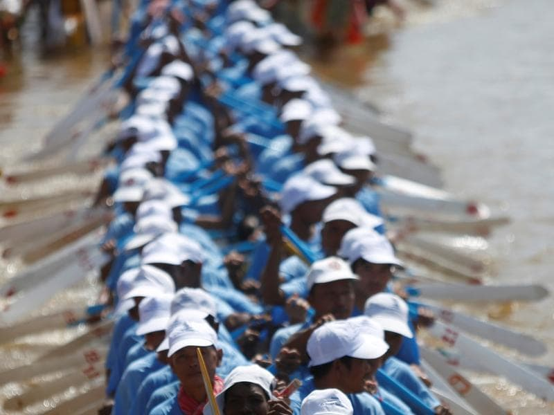 The three-day festival, which started on Sunday, commemorates the kingdom's ancestral naval warriors. Which Indian festival are you reminded of, looking at these Cambodian rowers? (Reuters)