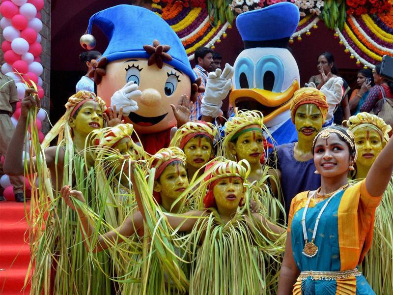 Children pose for a selfie during the children's day celebrations at Bengaluru on Monday.  (PTI)