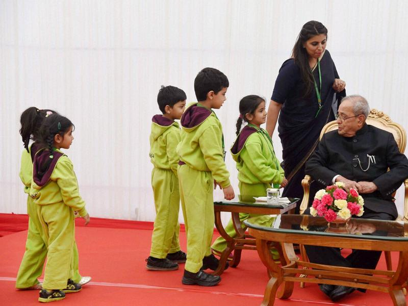 President Pranab Mukherjee being greeted by children during the children's day function in New Delhi on Monday. (PTI)