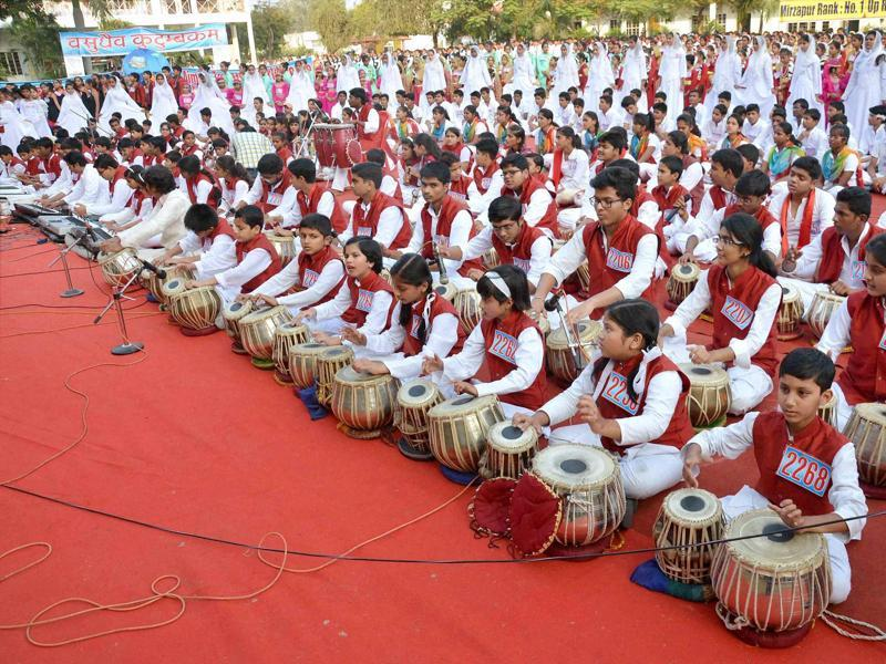 School children participating in a musical program for world peace on the occasion of Children's Day in Mirzapur, Uttar Pradesh on Monday.  (PTI)