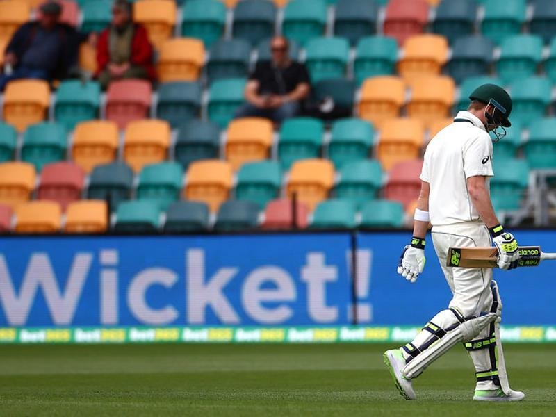 Australia's captain Steve Smith walks off the ground after being dismissed by South Africa's Kagiso Rabada. (REUTERS)