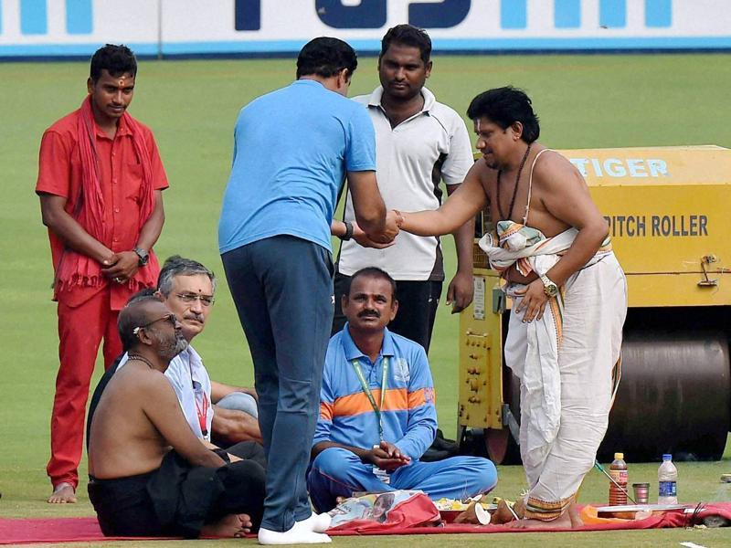A priest gives 'prasad' to India coach Anil Kumble after performing puja ahead of the second Test against England in Visakhapatnam on Wednesday. Kumble would be hoping the divine blessing will help his team to dominate the Test. (PTI)