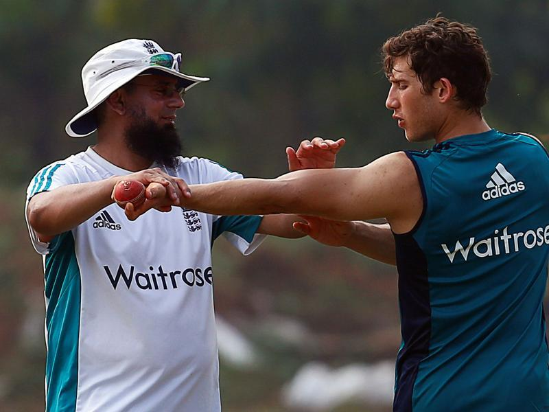 England's Zafar Ansari gets tips from former Pakistan ace spinner Saqlain Mushtaq. Ansari posed problems to the India batsmen in the drawn Rajkot Test. (REUTERS)