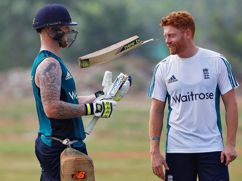 England's Ben Stokes (left) tosses his broken bat as Jonny Bairstow looks on. Both were fairly comfortable against the India spinners in Rajkot and will hope to carry their good form  in Visakhapatnam. (REUTERS)