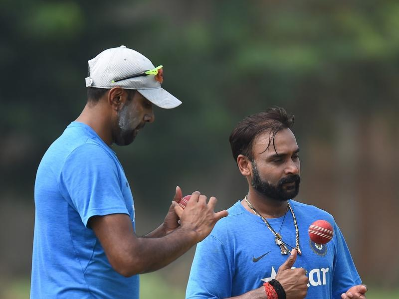 India's Ravichandran Ashwin (left) and Amit Mishra during nets  at the Dr. Y.S. Rajasekhara Reddy ACA-VDCA Cricket Stadium in Vishakhapatnam. England batsmen played both Ashwin and Mishra with relative ease in the drawn Rajkot Test. (AFP)