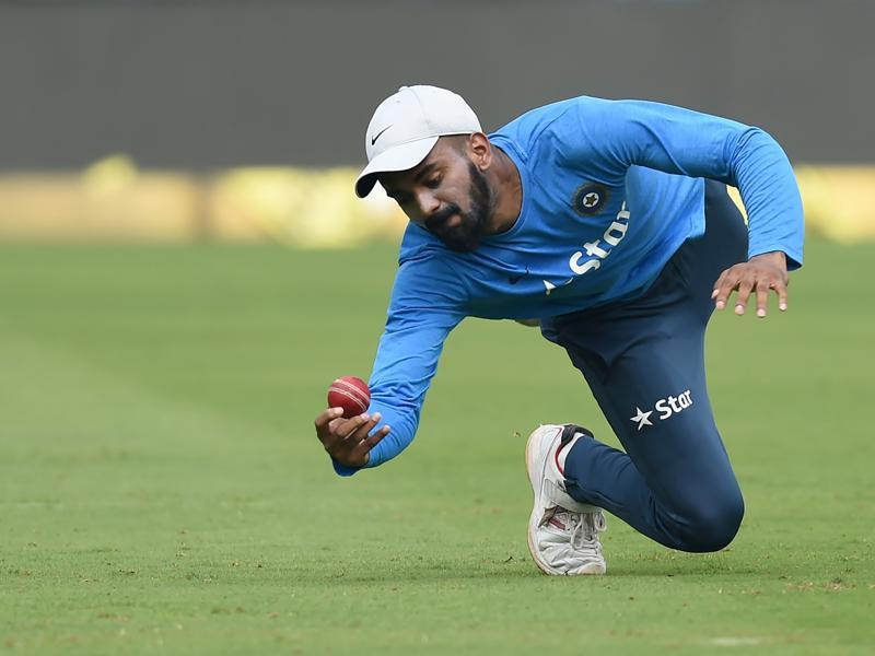 India's KL Rahul dives to take a catch during training. Rahul will takeover the opener's role from Gautam Gambhir after he recovered from his hamstring injury. (AFP)