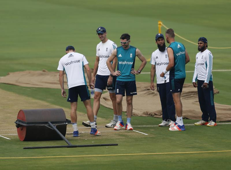 Members of England cricket team inspect the pitch. (AP)