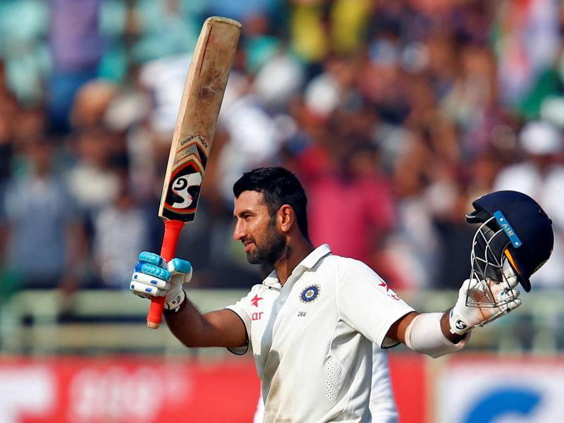 India's Cheteshwar Pujara celebrates after scoring his century. (REUTERS)