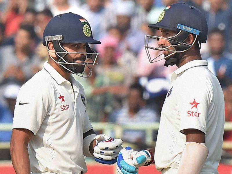 Virat Kohli and batsman Cheteshwar Pujara during the Day 1 of the 2nd Test cricket match. (PTI photo)