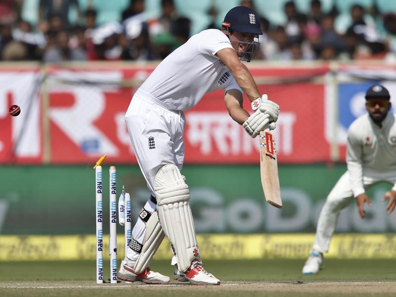 England's captain Alastair Cook is bowled out by India's Mohammed Shami. (AP Photo)