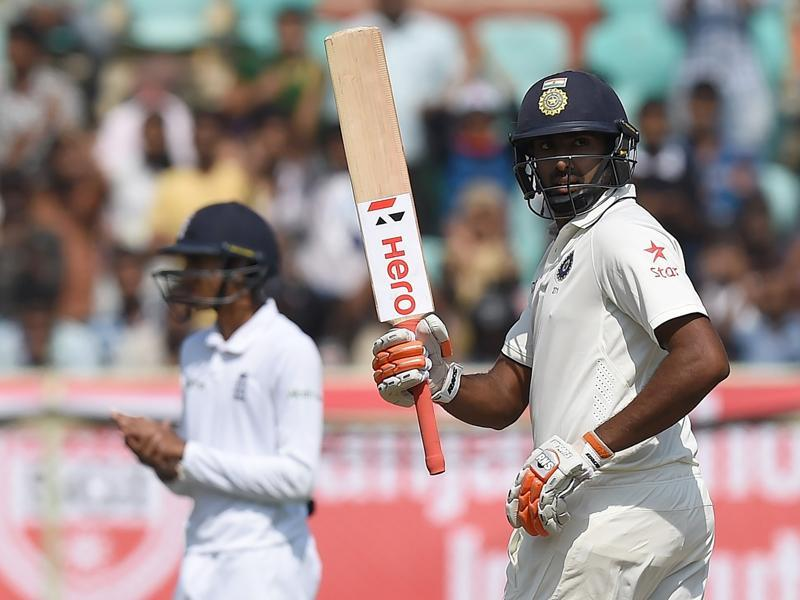 India's Ravichandran Ashwin raises his bat after his half century during the second day of the second Test cricket match. (AFP photo)