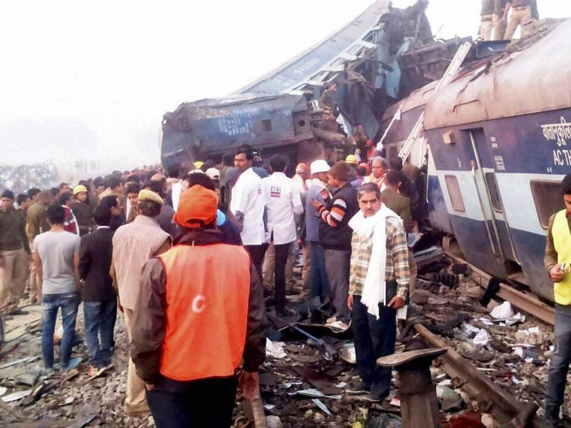 Rescue officials and locals on the site where the Indore-Patna Express was derailed. (PTI photo)