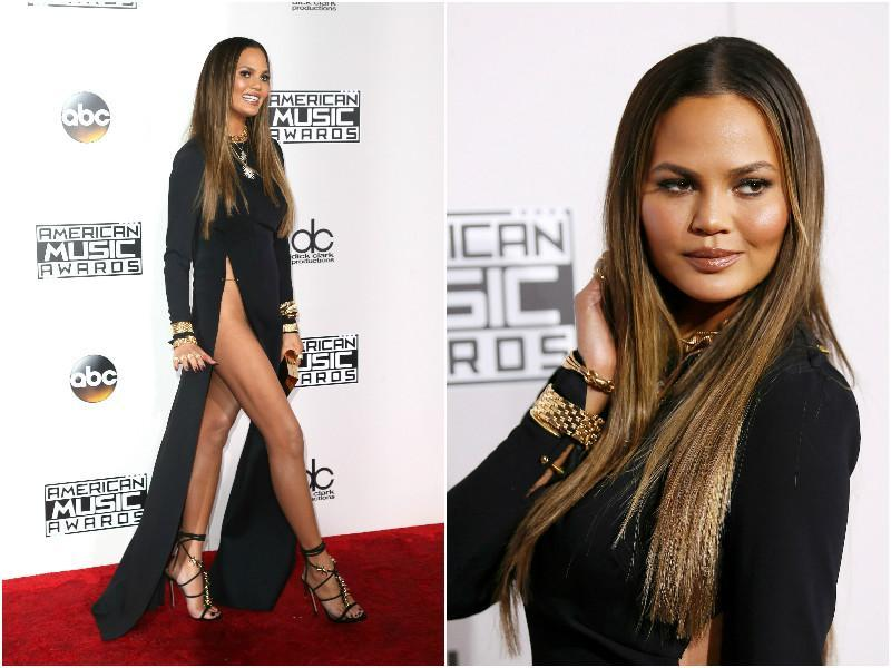 TV host and author Chrissy Teigen decided to take some risks and showed up in racy black number with a slit running all the way up to her torso. She completed her look with a lot of golden bling.
