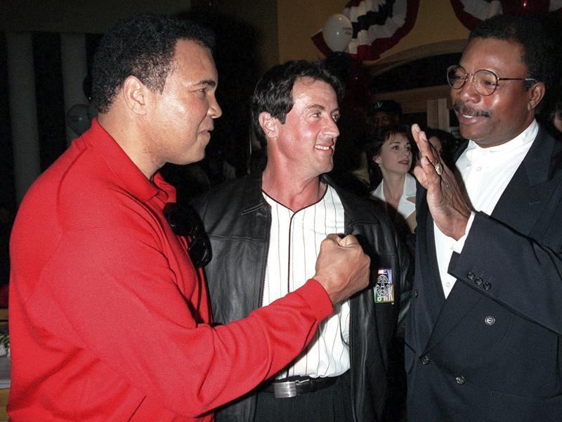 In this March 16, 1996 file photo, former heavyweight boxing champion Muhammad Ali, left, joins actor and screenwriter Sylvester Stallone, center, and Stallone's Rocky co-star, former professional football player Carl Weathers, right, to mark the 20th anniversary of the movie Rocky during a party in New York. (AP Photo)