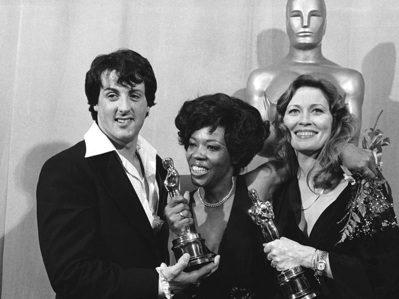 Clicked in March 28, 1977, this photo shows Sylvester Stallone with Eletha Finch and Faye Dunaway at the Academy Awards in Los Angeles. Rocky was among the winners that year. (AP Photo)