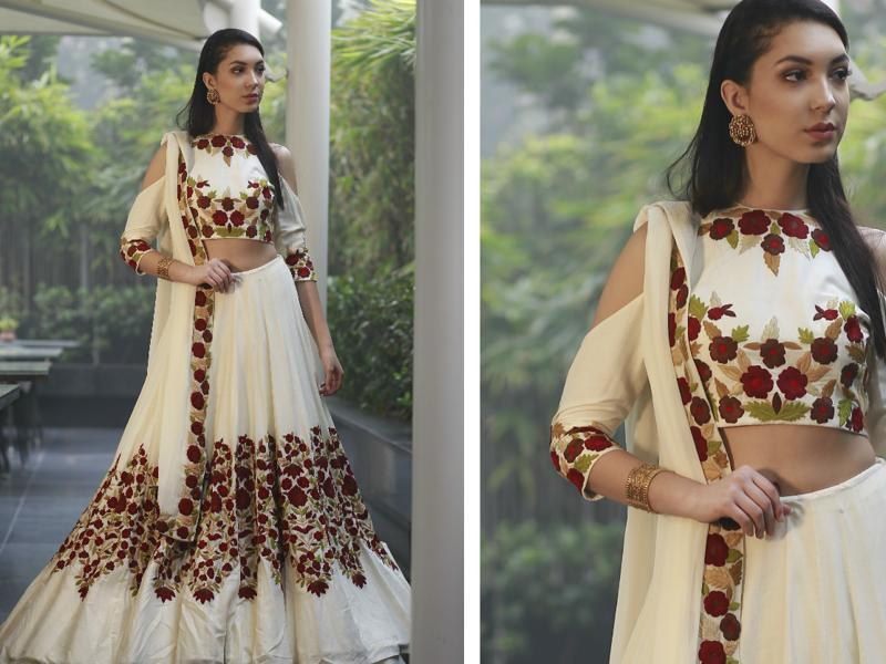 Model Rafaela Andrade wearing this  stunning white lehenga with floral motifs teamed with the 60's favourite cold-shoulder blouse.   (photos: Waseem Gashroo/HT)