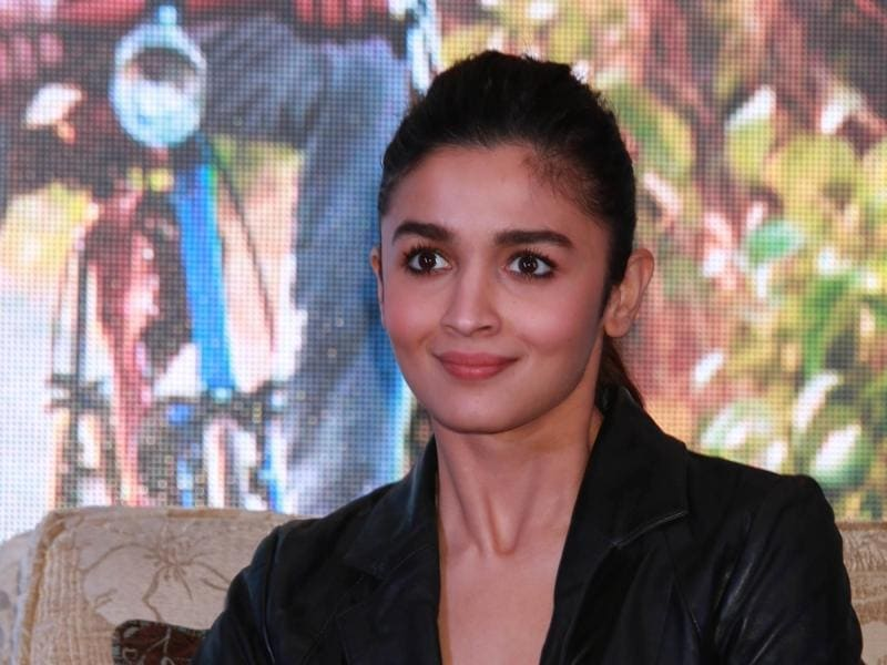 Alia Bhatt joined Shah Rukh Khan and director Gauri Shinde at a press conference to promote Dear Zindagi. (IANS)