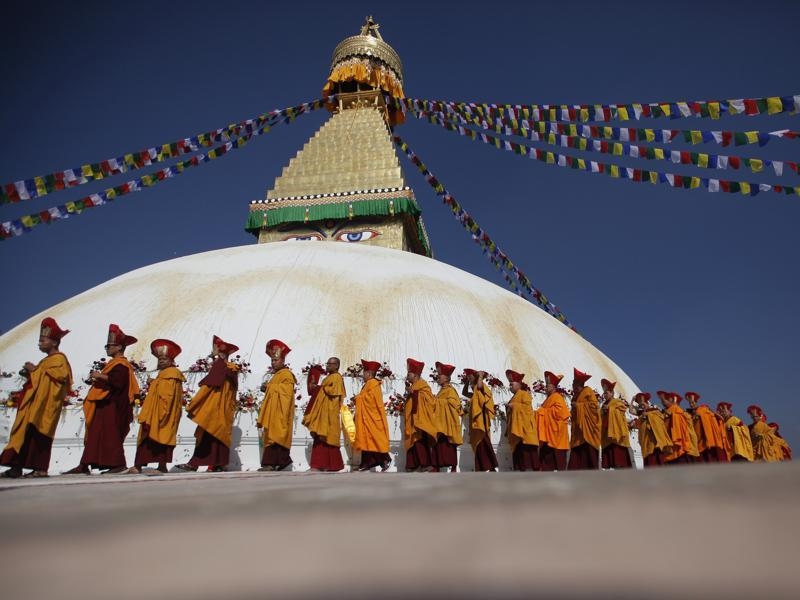 Buddhist monks circle around the Boudhanath Stupa during the final day of its purification ceremony in Kathmandu, Nepal. Boudhanath is a UNESCO World Heritage Site. (AP)