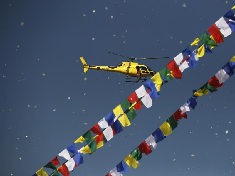 Flowers are showered from a helicopter during the final day of the purification ceremony. Boudhanath and Swayambhunath are the two most popular tourist destinations in Nepal. (AP)