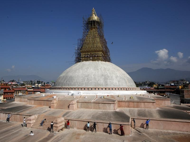 Nepalese volunteers work at the reconstruction site of stupa . It sits on the ancient trade route from Tibet to Kathmandu valley. (AP)