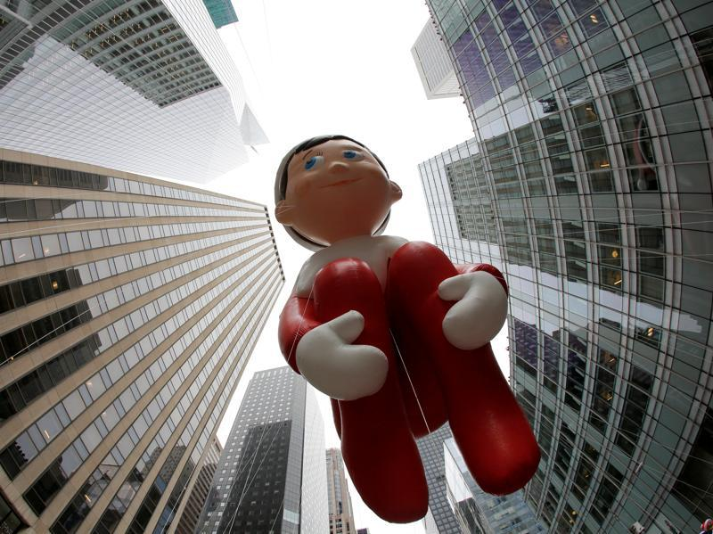 The Elf on the Shelf balloon is carried down 6th Avenue. (REUTERS)
