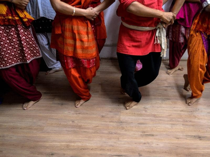 Dance students participate in an Odissi dance lesson under the tutelage of acclaimed dancer Madhumita Raut inside a garage-turned-studio in New Delhi.  (AFP)