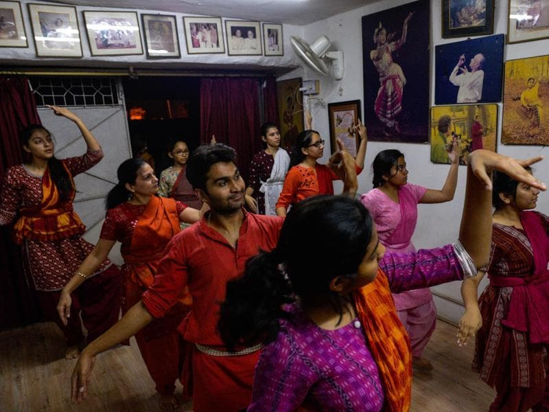 Students elegantly curve their hands before breaking into synchronised footwork at a class in New Delhi, where growing numbers are signing up for Indian traditional dance classes rooted in Hindu mythology.  (AFP)