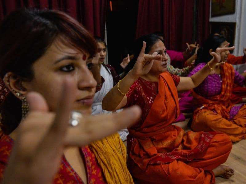 Class participants range from pre-teens to surgeons and marketing managers -- but they have all chosen to learn traditional Indian dance, which emerged from the country's temples centuries ago, over western options such as ballet, jazz and hip hop.  (AFP)