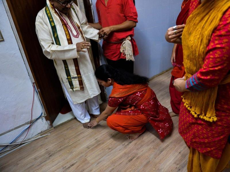 A students seek blessings of their seniors at an Odissi dance lesson inside a garage-turned-studio in New Delhi. Belonging to the Vaishnava (Vishnu) tradition, it can be adapted to traditions of Shiva, Surya and Hindu goddesses (Shakti).  (AFP)