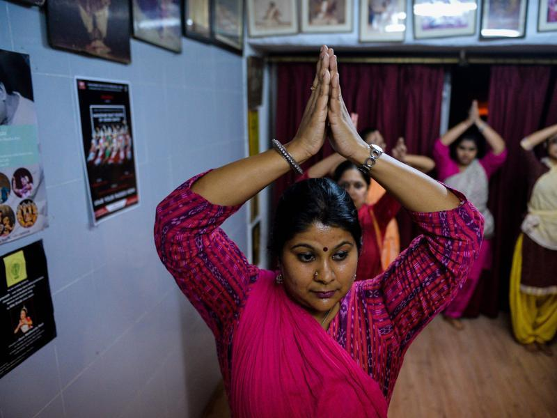 Dance student Priyanka Venkateswaran (36) participates in a lesson. Odissi is primarily performed by women but male dancers also feature. (AFP)