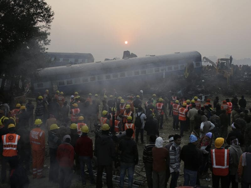 Rescuers at an accident site where 14 coaches of an overnight passenger train rolled off the track near Pukhrayan village in Kanpur Dehat district, Uttar Pradesh, on November 20, 2016. The mishap, believed to have been caused due to a fracture in the rail tracks, killed 150 passengers and dozens of others.  (Rajesh Kumar Singh/AP)