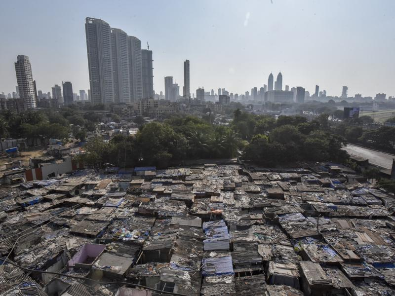 Mumbai's heritage washing zone and the world's largest open-air laundry, popularly known as 'Dhobi Ghat', is set to become slum-free. Spread across 12 acres, Dhobi Ghat  houses nearly 5,000 slum tenements and 25,000 people from the dhobi community. On November 25, about 800 houses were razed, marking the commencement of the redevelopment project. (Kunal Patil/HT Photo)